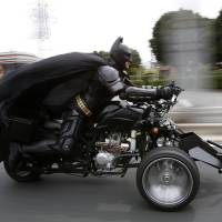 A 41-year-old man going by the name of Chibatman rides his 'Chibatpod' Sunday on the road in Chiba, east of Tokyo. | REUTERS