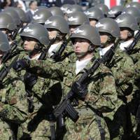 Members of the Self-Defense Forces march at Asaka Base, Saitama Prefecture, on Oct. 27, 2013. | AP