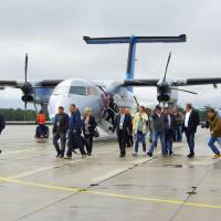 Passengers disembark at a newly built airport on Etorofu Island, on the Russian-held islands off Hokkaido, on Wednesday. Russia calls the island Iturup.   COURTESY OF A LOCAL RESIDENT/KYODO