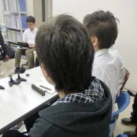 A 32-year-old Saitama Prefecture woman without a family register holds a press conference in Kobe Thursday after the Kobe Family Court ruled that she can use her mother's register.   KYODO