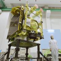 The Hayabusa2, an asteroid explorer developed by the Japan Aerospace Exploration Agency, is unveiled at a JAXA facility in Sagamihara, Kanagawa Prefecture, on Sunday. | KYODO