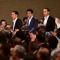 Prime Minister Shinzo Abe arrives at a seminar to deliver a speech in Tokyo on Friday. | AFP-JIJI