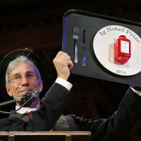 Marc Abrahams, master of ceremonies and editor of the Annals of Improbable Research, holds one of this year's prizes at the 24th First Annual Ig Nobel Prizes awards ceremony at Harvard University in Cambridge, Massachusetts, on Thursday. The annual prizes, meant to entertain and encourage global research and innovation, are awarded by the Annals of Improbable Research as a whimsical counterpoint to the Nobel Prizes, which will be announced next month. | REUTERS