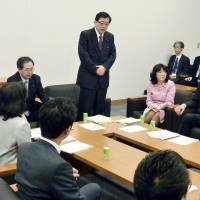 Taku Yamamoto (center), a leading proponent of building underground nuclear power plants to replace the nation's aging reactors, addresses a meeting in the Diet building in April. | KYODO