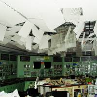 Panels dangle from the ceiling of the reactors 1 and 2 control room at the Fukushima No. 1 plant on March 12, 2011, after a hydrogen blast in the reactor 1 building. | TEPCO/KYODO