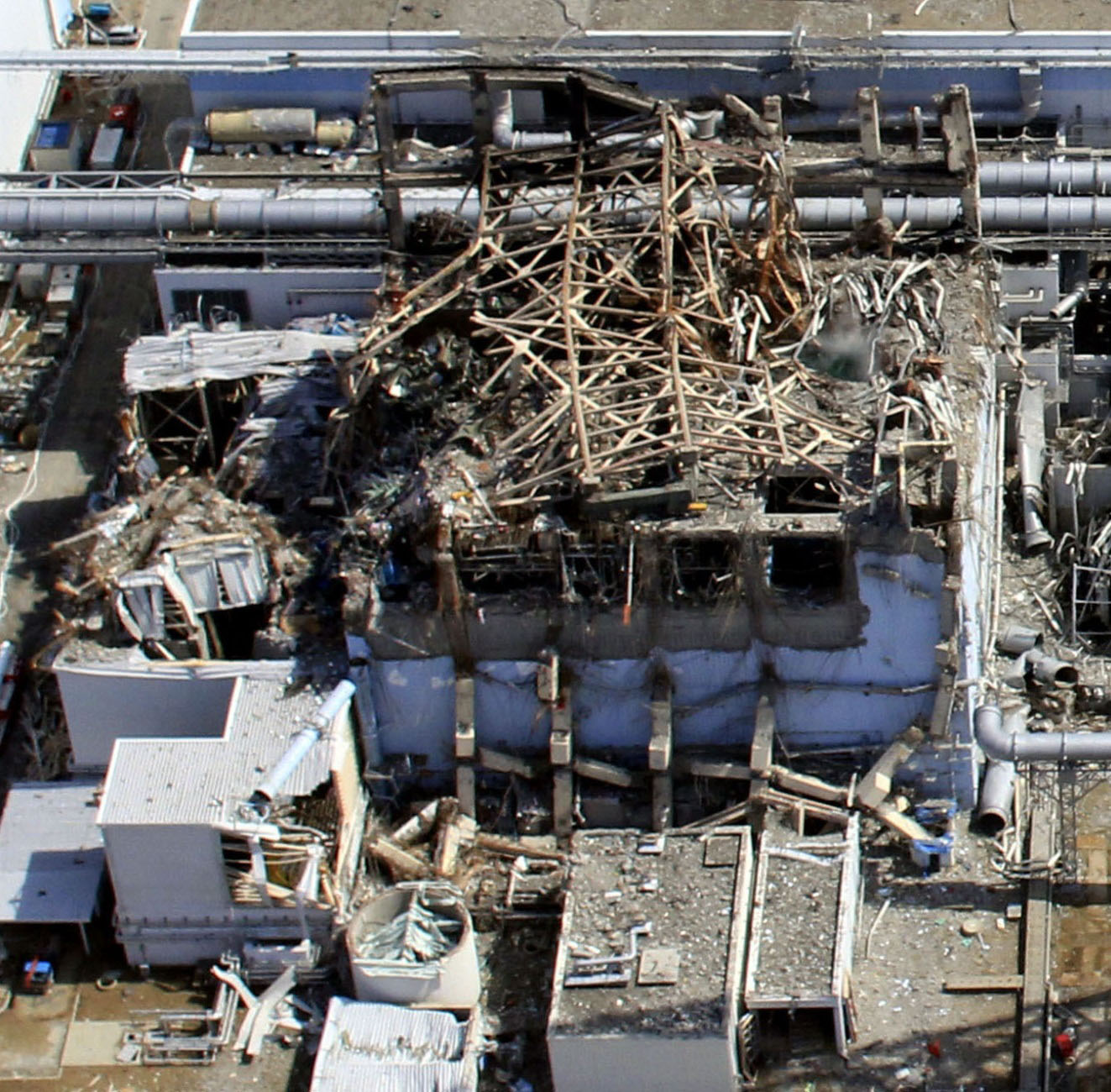 The mangled remains of the No. 3 reactor building at the Fukushima No. 1 power plant are shown on March 24, 2011, after a massive hydrogen explosion. | AIR PHOTO SERVICE/KYODO