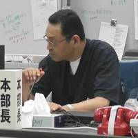 Masao Yoshida, chief of the Fukushima No. 1 nuclear plant when it suffered three catastrophic meltdowns, oversees the emergency response headquarters in May 2011. | TEPCO/KYODO