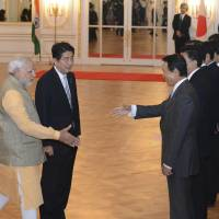 Indian Prime Minister Narendra Modi is introduced by Prime Minister Shinzo Abe to Finance Minister Taro Aso during a welcome ceremony at the Akasaka State Guesthouse in Tokyo on Monday. | AP