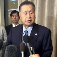 Former Prime Minister Yoshiro Mori speaks to reporters after meeting with Russian President Vladimir Putin in Moscow on Wednesday. | KYODO