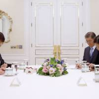 Former Prime Minister Yoshiro Mori (left) meets with South Korean President Park Geun-hye (right) in Seoul on Friday, on the sidelines of the opening ceremony for the 17th Asian Games.   AP