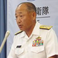 Adm. Katsutoshi Kawano, chief of staff of the Maritime Self-Defense Force, holds a news conference Monday at the Defense Ministry over a crewman who killed himself after being bullied by a superior. | KYODO