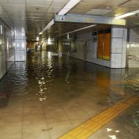 A section in Nagoya Station is filled with water after torrential rain hit the area in the early hours of Thursday. | KYODO