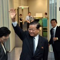 Ho Jong Man, chairman of the General Association of Korean Residents in Japan (Chongryon), waves at Tokyo's Haneda airport as he prepares to fly to Pyongyang via Beijing on Friday to attend a ceremony for the North Korean national foundation day. | AFP-JIJI