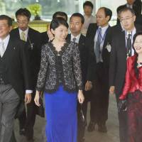 Newly appointed Cabinet ministers Shigeru Ishiba (left), Yuko Obuchi (center) and Midori Matsushima (right) leave the Prime Minister's Official Residence to attend a confirmation ceremony at the Imperial Palace in Tokyo on Wednesday afternoon. | KYODO