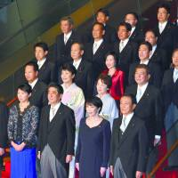 Members of the new Cabinet of Prime Minister Shinzo Abe pose for the traditional photo at the prime minister's office in Tokyo' Nagatacho district Wednesday evening.   YOSHIAKI MIURA