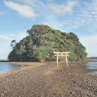 Island shrine is picturesque destination for tourists and pilgrims alike