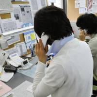 Counselors for a free 24-hour hotline speak to survivors of the March 2011 disasters. | KYODO