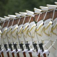 Members of a Self-Defense Forces' honor guard prepare to be inspected by French Defense Minister Jean-Yves Le Drian at the Defense Ministry in Tokyo in July.   AP