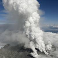 Smoke billows from vents on Mount Ontake, which straddles the Nagano-Gifu prefectural border, on Saturday. | KYODO