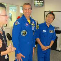 Japanese astronaut Koichi Wakata (right) was reunited with former International Space Station colleague Richard Mastracchio (left), of NASA, at Goddard Space Flight Center in Maryland on Wednesday. | KYODO