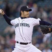 Not his day: Seattle's Hisashi Iwakuma throws a pitch against Houston in the first inning on Wednesday night.   AP