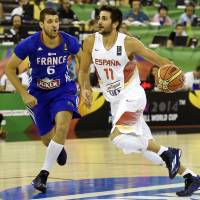 Catalyst for victory: Spain's Ricky Rubio drives on France's Antoine Diot during their Group A match on Wednesday. Spain won 88-64. | AFP-JIJI
