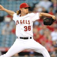 Wins 18th game: Los Angeles starter Jered Weaver throws a pitch against Texas in the first inning on Saturday.   REUTERS/USA TODAY SPORTS