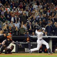 Counting down: New York's Derek Jeter hits an RBI groundout against Baltimore in the third inning on Monday night. The Yankees blanked the Orioles 5-0. | REUTERS/USA TODAY SPORTS