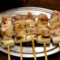 An old favorite: Negima (chicken and Welsh-onion skewers) at Toriki. | ROBBIE SWINNERTON
