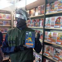 Dressed for the occasion: A 'Naruto' fan holds up his latest purchase at the 2014 Bangalore Comic Con. | SIMON & SCHUSTER INDIA
