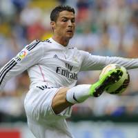 Ronaldo powers Real Madrid with hat trick in rout