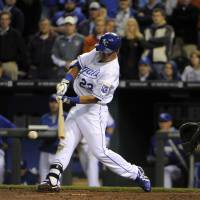Clutch: Kansas City's Norichika Aoki strokes a double in the ninth inning against Chicago on Monday night. | REUTERS/USA TODAY SPORTS