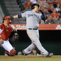 Crucial clout: Seattle's Logan Morrison watches his three-run homer against Los Angeles leave the yard on Thursday. | REUTERS/USA TODAY SPORTS