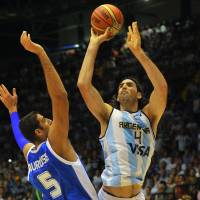 Soft touch: Argentina's Luis Scola puts up a shot against Greece's Giannis Bourousis in FIBA World Cup action on Thursday. | AFP-JIJI