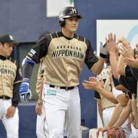 Anything you can do: Shohei Otani has been solid both at the plate and on the mound for the Fighters this year. | KYODO