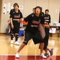 Trading places: Asako Oh left China as a teenager in order to play basketball in Japan.   KAZ NAGATSUKA