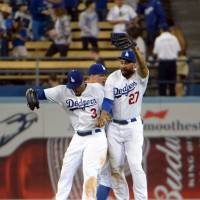 Hip hop hooray: Dodgers outfielders Carl Crawford (left), Matt Kemp (right) and Joc Pederson celebrate on Tuesday. | REUTERS/USA TODAY SPORTS