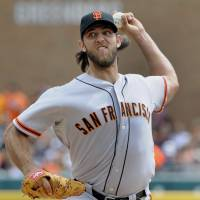 Notches 17th victory: San Francisco's Madison Bumgarner throws a pitch against Detroit in the first inning on Saturday. | AP