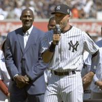 The Captain: Derek Jeter makes a speech during a pregame ceremony as Michael Jordan listens on Sunday in New York. Jeter was honored prior to the Yankees' 2-0 loss to the Royals. | KYODO
