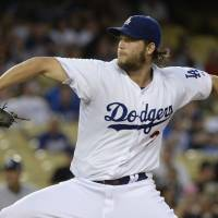Tough to beat: Los Angeles starter Clayton Kershaw fires a pitch against San Diego on Monday night. | REUTERS/USA TODAY SPORTS