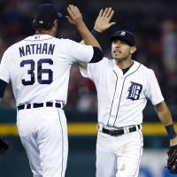 Up high: Tigers second baseman Ian Kinsler (right) celebrates with closer Joe Nathan after their 4-2 win over the Royals on Tuesday in Detroit. | REUTERS/USA TODAY SPORTS