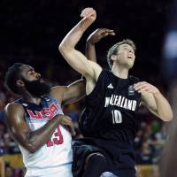 Fear the Beard: U.S. guard James Harden (left) vies with New Zealand's Thomas Abercrombie on Tuesday. | AFP-JIJI