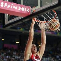 Throw it down: Mason Plumlee of the U.S. dunks during the team's 119-76 win over Slovenia on Tuesday. | REUTERS