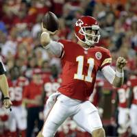 Big commitment: The Kansas City Chiefs have signed QB Alex Smith, who is entering his second season with the team, to a four-year, $68 million contract extension. | AP