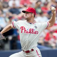 First leg: Philadelphia starter Cole Hamels throws a pitch against Atlanta in the second inning Monday. The Phillies won 7-0. | AP