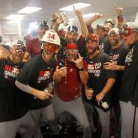 Strike a pose: The Nationals celebrate in the clubhouse after clinching the NL East title on Tuesday. | REUTERS/USA TODAY SPORTS