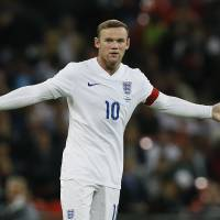 A struggle: Wayne Rooney scored England's lone goal, his 41st overall, against Norway in Wednesday's friendly. But Rooney and Dean Sturridge have struggled to develop strong chemistry in two years paired together under Roy Hodgson. | AP