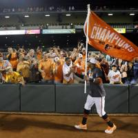 Capture the flag: Orioles outfielder Adam Jones high-fives fans after Baltimore's 8-2 victory over Toronto on Tuesday night. The Orioles clinched their first AL East division title since 1997 with the win. | AP