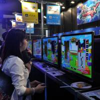 The Tokyo Game Show offers gamers a hands-on preview of what is about to hit the market. It is also a place where they can meet like-minded enthusiasts. | YOSHIAKI MIURA