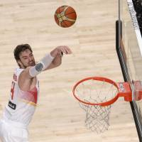 Rout: Spain's Pau Gasol puts up a shot against Senegal in their second-round game at the FIBA World Cup in Madrid on Saturday. Spain won 89-56. | AFP-JIJI
